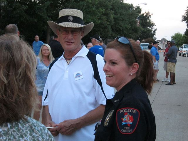 Officer in uniform chats with participants